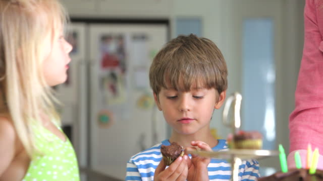 Young Boy Enjoying Cupcake At Birthday Party video