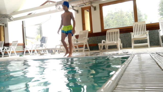 Young boy in an indoor swimming pool