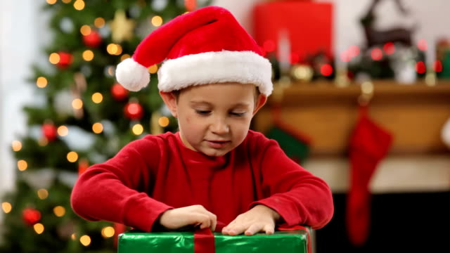 Young boy opening a Christmas gift video