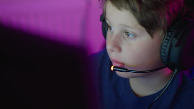 Young boy playing online computer games