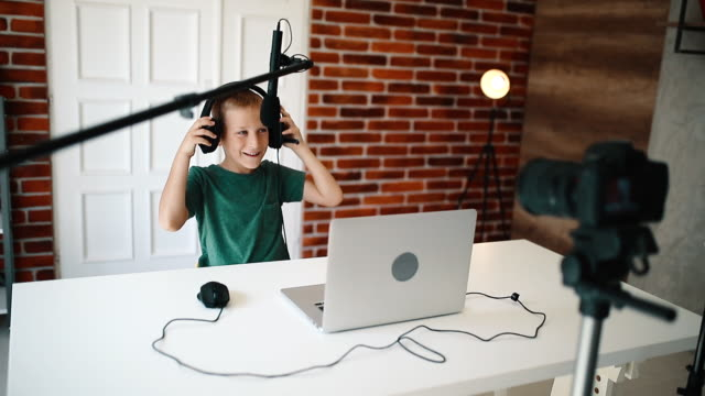 young boy playing online computer games - preadolescente video stock e b–roll