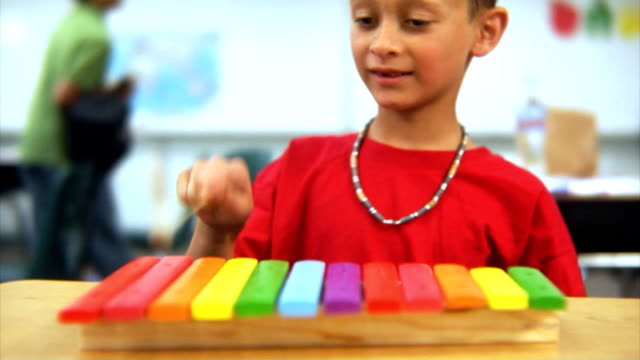 Young boy playing xylophone video