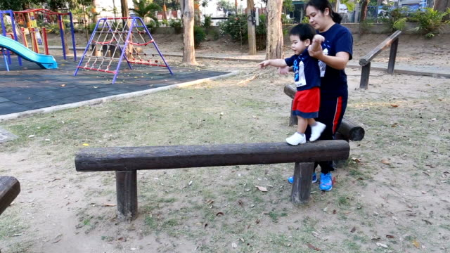 Young boy practising on balance beam video