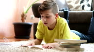 istock Young boy reading in his room 1218730385