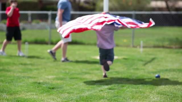 Young boy running with American flag video