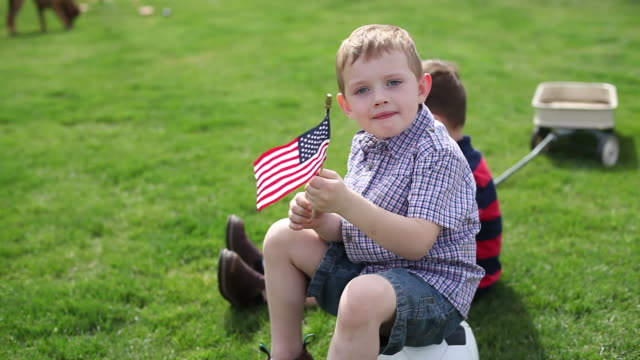 Young boy waving American flag  less than 10 seconds stock videos & royalty-free footage