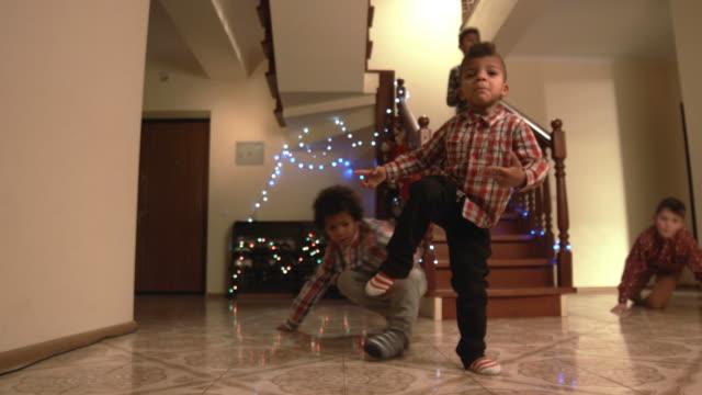 stockvideo's en b-roll-footage met jonge jongens kerst dans. - christmas tree