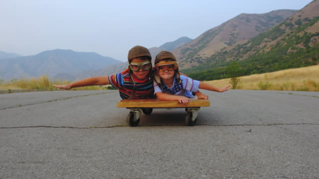 Young Boys Flying on a Press Cart