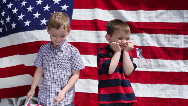 Young boys waving American flags video