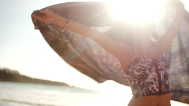 Young brunette woman with scarf on a beach video