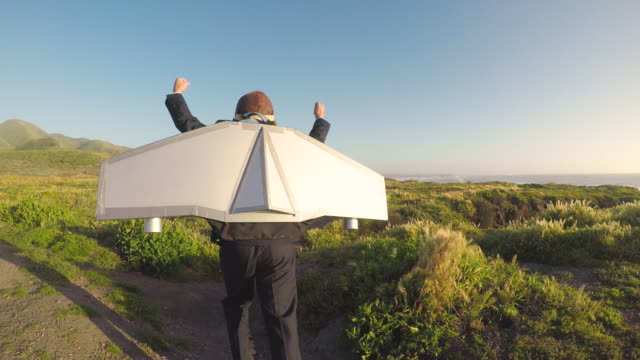 Young Business Boy Flies Jet Pack in California