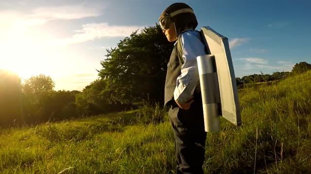 vídeos de stock e filmes b-roll de young business boy with jet pack in england - crianças todas diferentes