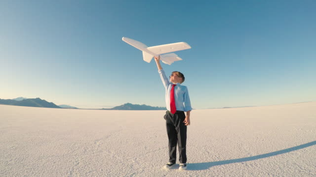young business boy with toy airplane - scoprire nuovi terreni video stock e b–roll