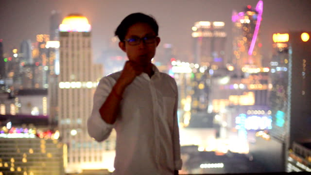 Young business man look to cityscape, asian video