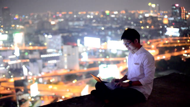 Young business man using laptop Online shopping with smart phone