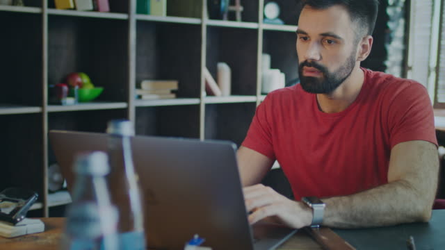 young business man working on laptop in home office. modern manager - ricevere video stock e b–roll