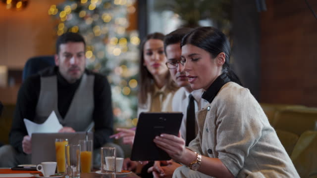 Young business people using digital table at the cafe