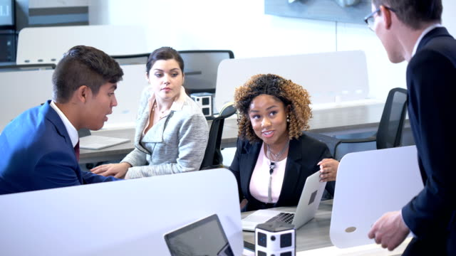 Young business people working in shared office space