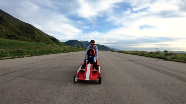 Young Business Team Races a Go Cart