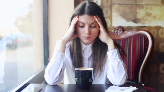 Young business woman being sad. video