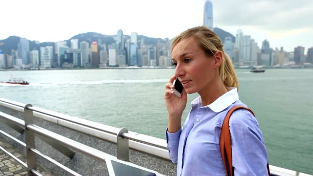 Young business woman on the phone in Hong Kong video