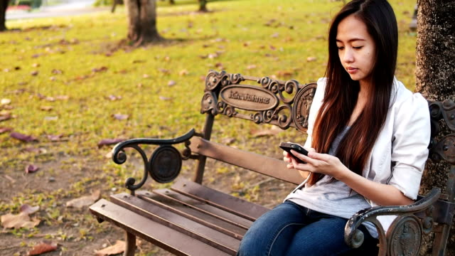 Young business Woman Using A Smart Phone video