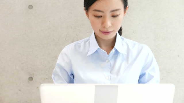young business woman using PC video