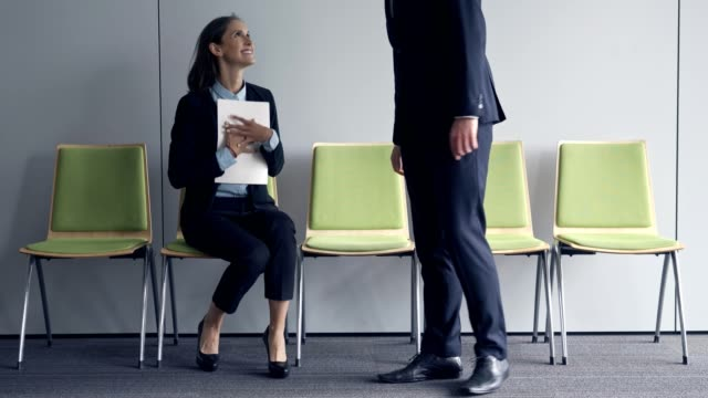 Young business woman waiting for job interview Young business woman waiting for job interview job interview stock videos & royalty-free footage