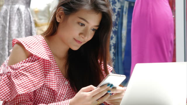 young business woman working with laptop and smart phone - owner laptop smartphone video stock e b–roll