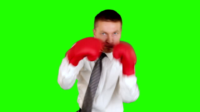 Young businessman boxing and hitting himself, close-up, Green Screen video