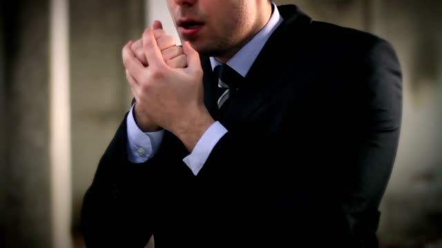 Young Businessman Cold Flu Freezing Hands video