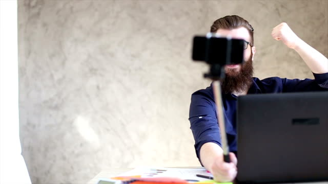 Young businessman having fun in office video