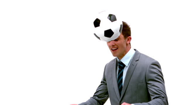 stockvideo's en b-roll-footage met young businessman heading football away - overhemd en stropdas