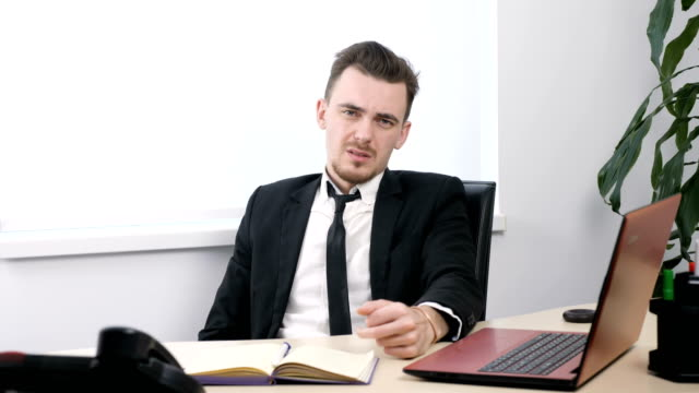 Young businessman in suit sitting in office and showing fuck sign 60 fps Young businessman in suit sitting in office and showing fuck sign 60 fps 4k middle finger stock videos & royalty-free footage