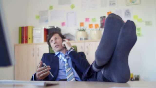 Young businessman in the office video