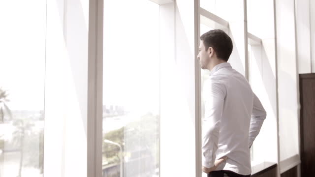 Young Businessman Looking out Window video
