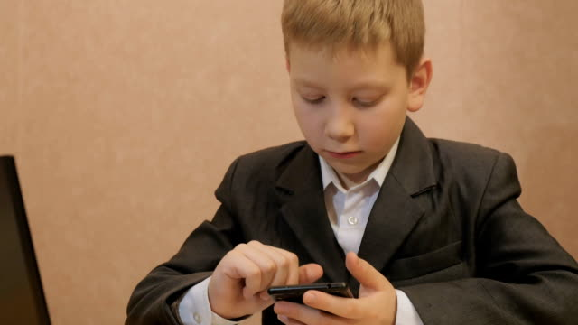 Young businessman using a smartphone video