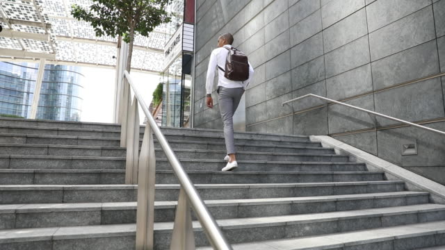 Young businessman walks to the office video