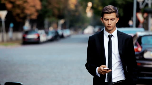 Young businessman with a phone in his hand. video