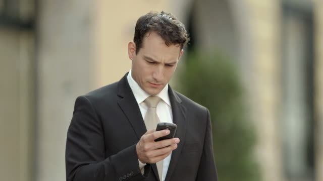 HD: Young Businessman With A Phone video