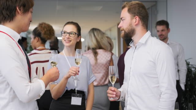 Young Businesspeople Toasting with Champagne at Party video