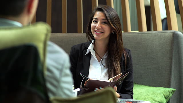 4K :Young businesswoman during job interview at the coffee shop. video
