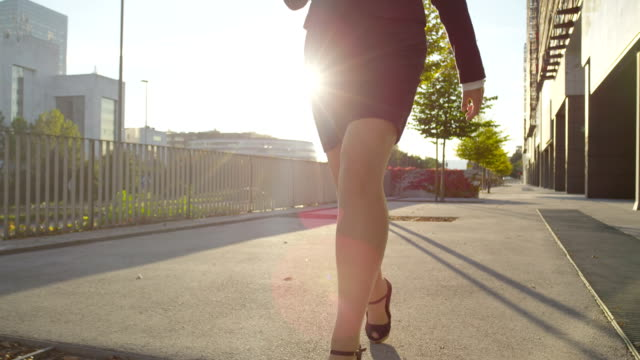 CLOSE UP: Young businesswoman going to work in high heels video