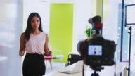 istock Young businesswoman making an instructional video 938930912