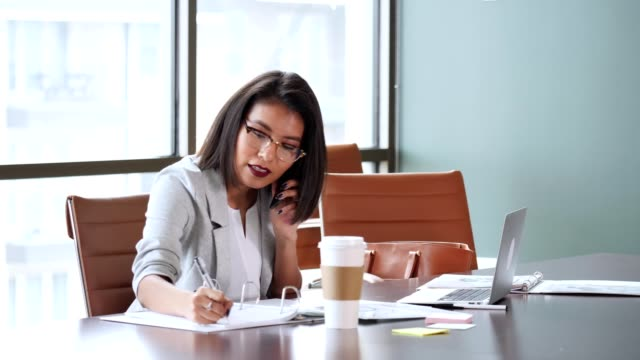 Young businesswoman on business call