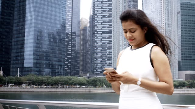Young Businesswoman Using Mobile Phone Outdoors video