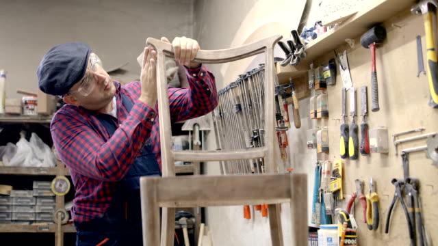 Young carpenter restoring old furniture