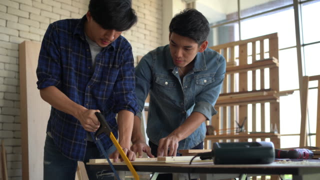 Young carpenters working