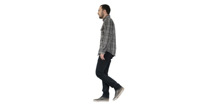 Young casual man walking on white background