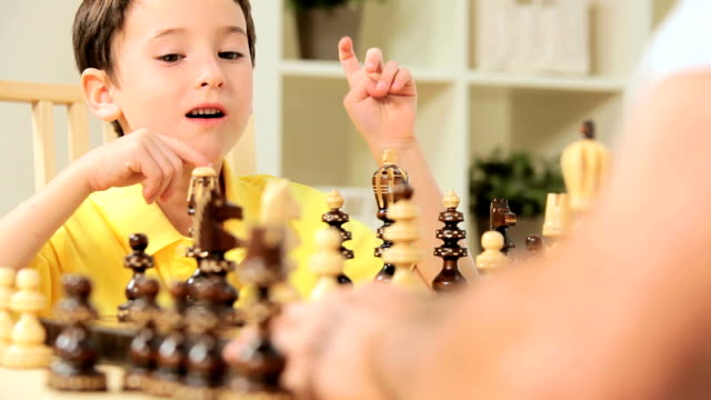 Young Caucasian Boy Playing Chess video